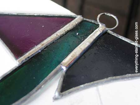 hook soldered to stained glass