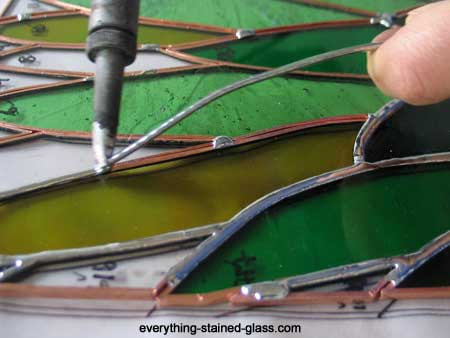 Getting a smooth soldered seam on green stained glass