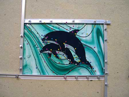 squaring stained glass dolphin panel