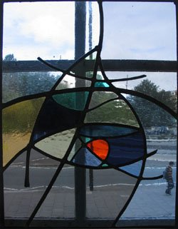 muted grey and blue stained glass panel