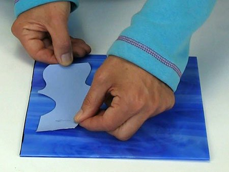 sticking template on blue glass