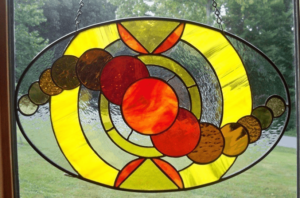 Oval stained glass panel by Lori Jones