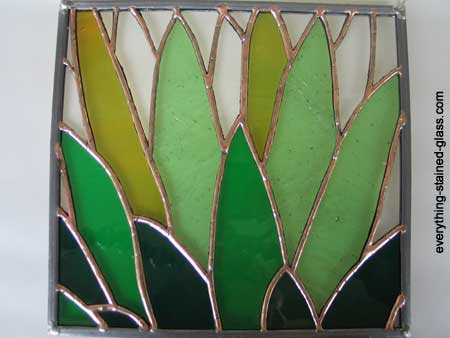 finished stain glass panel with copper patina