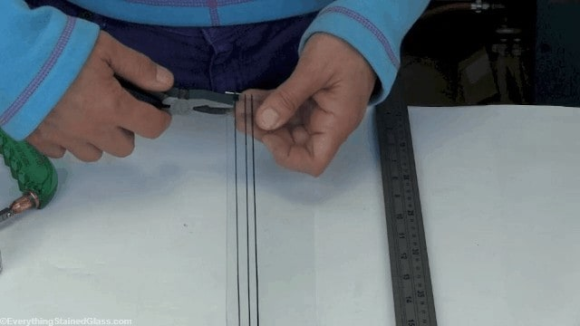cutting thin strips of stained glass