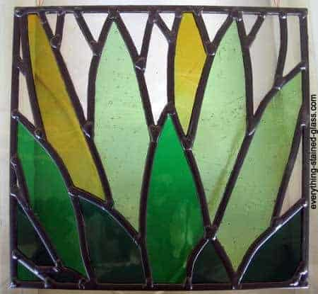 black patina on stained glass leaf panel
