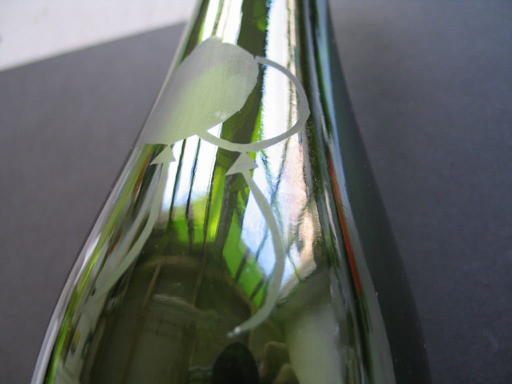 green bottle with etched balloons