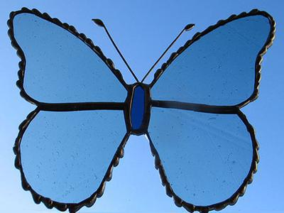 blue glass butterfly with decorative soldered edge