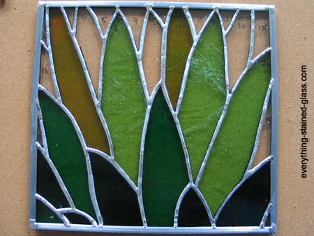 stained glass panel soldered to zinc frame