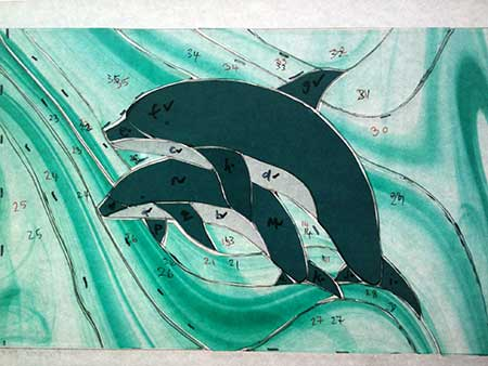 cut dolphin stained glass pieces