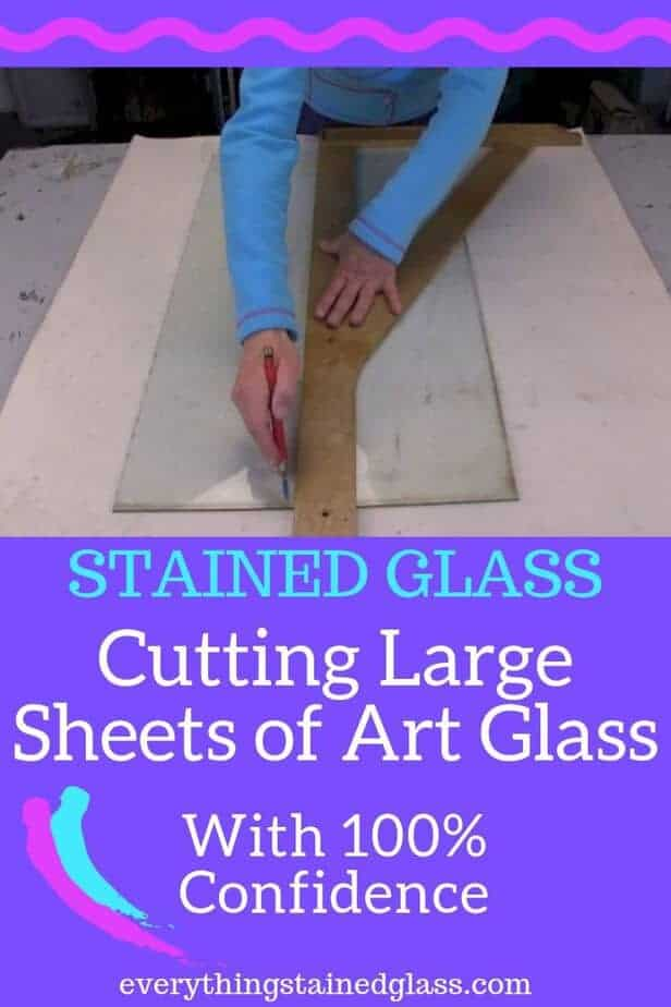 Cutting large sheets of stained glass by hand using a cutter and set square ruler