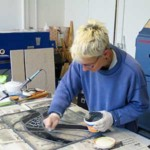 Milly Frances working in stained glass studio