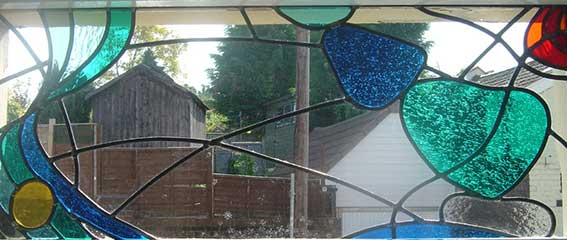 cutting stained glass for window panel